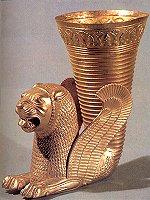 Golden drinking cup from the Achaemenian period, ornamented with a winged lion.